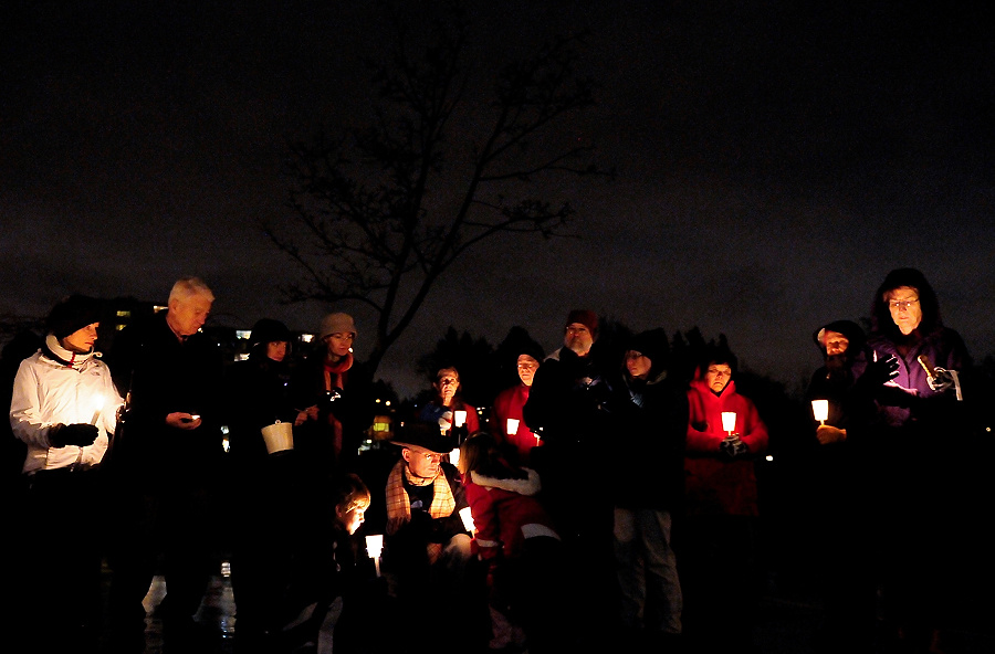 A group of about 40-50 people gather on the basketball courts at Green Lake Park during a candlelight vigil in remembrance of the Newtown shooting victims in Seattle on Saturday, December 15, 2012. Yesterday Adam Lanza killed his mother, a substitute teacher at Sandy Hook Elementary, before heading to the school and killing 26 adults and children. Lanza shot himself afterwards, bringing the final death toll to 28 people. (Photo by Lindsey Wasson)